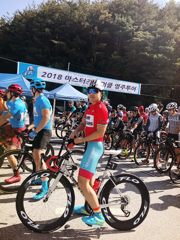 Myself on Masters Cycling Tour Korea, 2018 Eumseong tour, with GC leader's jeresey