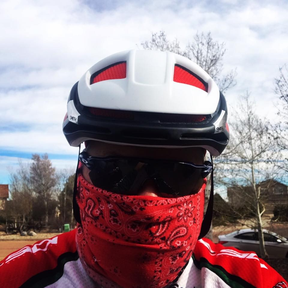 It's not a COVID social distancing mask. It was 40 degrees and cold because Colorado cyclists do it year round.